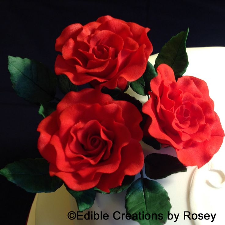 Small red sugarpaste roses and leaves by Edible Creations by Rosey