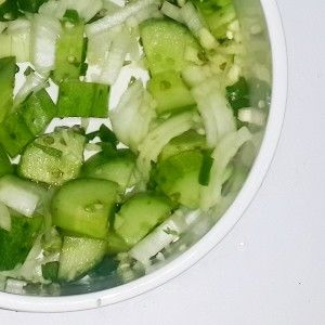 Cucumber Salad [Photo by Natural Nibs]  http://naturalnibs.com/home/2015/05/20/the-bull-horn-salad/