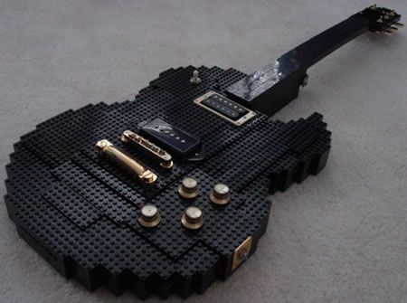 Cool guitars | Check out this cool guitar made out of black plastic LEGO building ...I would have no patience for that.