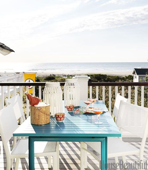 "Fermob's Costa extension table carries turquoise onto the deck. ""Pulling off all this color would have been much harder if I had used more colors, and different colors in all the rooms,"" says Berman. ""The fluidity is both calming and celebratory. It says, 'I can relax here and have fun.'""   - HouseBeautiful.com"
