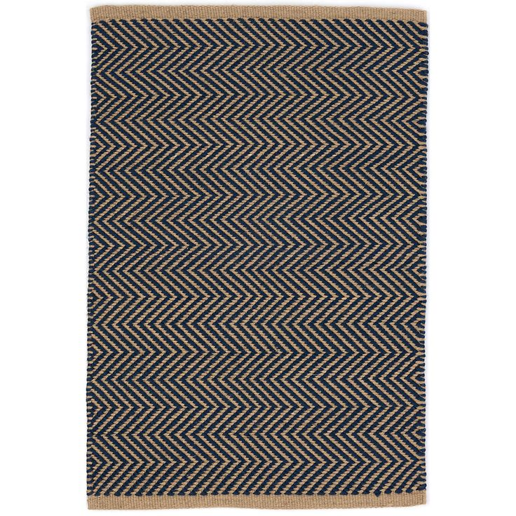 The thickest of our indoor/outdoor PET rugs, this classic navy and camel zigzag pattern offers subtle geometric interest on a durable, easy-care floor covering for the porch, patio, kitchen, or hallway.Made of 100% PET, a polyester fiber made from recycled plastic bottles.In order to achieve its rustic charm, this rug has been woven with large-diameter yarns. Consequently, slubs, knots, and other imperfections inherent to the hand-weaving process may be more visible on this style of rug…