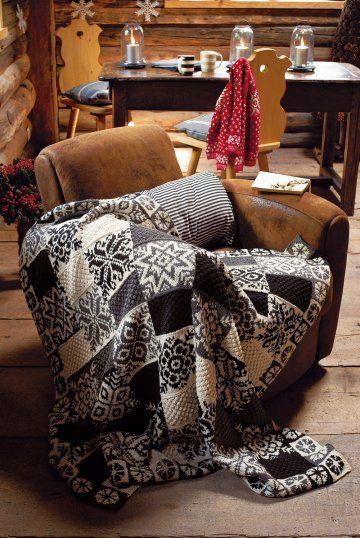 Un plaid tricoté en patchwork de jacquard noir, blanc et gris /  A tartan rug in patchwork of Jacquard loom, black, white and grey, stars