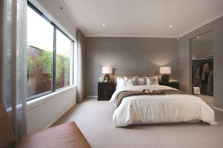 This oriental inspired master bedroom has a beautiful moodiness through the use of dark timber, large table lamps and stone wallpaper. Fresh white bed linen and caramel leather occasional chair add a contemporary feel to allow a mix of old and new. As displayed in Kew 28 and Berwick Waters.