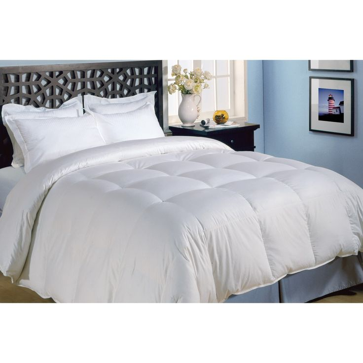 Curl up with this microfiber down alternative comforter. Constructed of soft cotton, this luxurious yet lightweight comforter is filled with hypoallergenic polyester. No need for dry-cleaning bills, this end-to-end box comforter is machine washable.