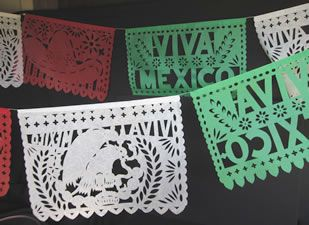 papel picados in mexican flag colors