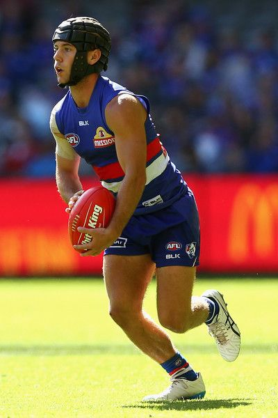 Caleb Daniel of the Bulldogs looks to pass the ball during the round one AFL match between the Western Bulldogs and the Fremantle Dockers at Etihad Stadium on March 27, 2016 in Melbourne, Australia.