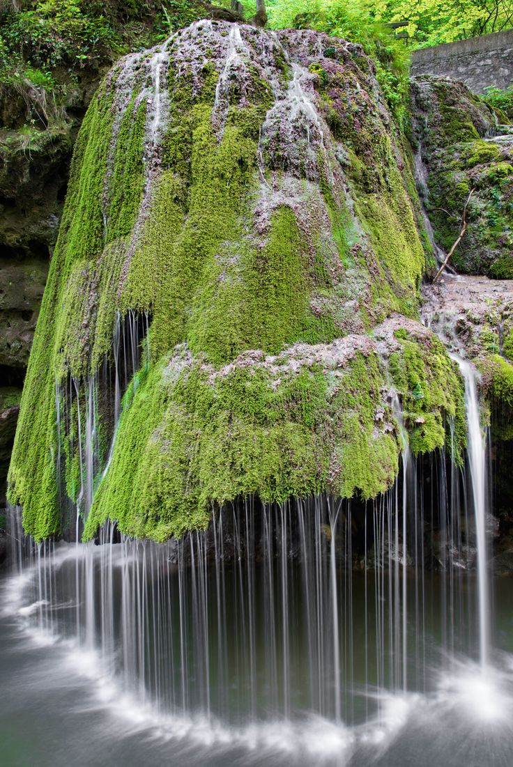 The water on this waterfall in Romania rolls off of a green carpet of moss that covers the rock formation — which results in a magically soft display, much unlike a roaring waterfalls.   - HouseBeautiful.com