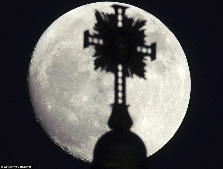 *2011 supermoon...The moon is obscured by the cross of Frauenkirche (Church of Our Lady) in Dresden, Germany, this evening