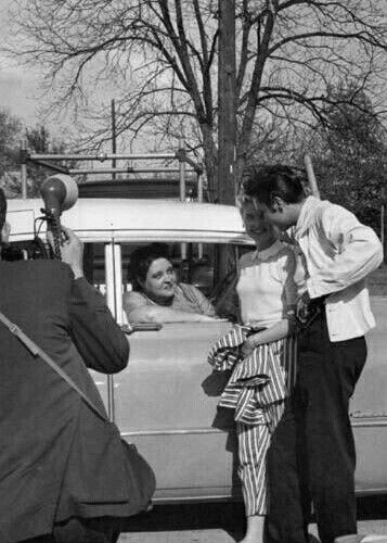 April 19th, 1957: Gladys in her Pink Cadillac, keeping a watchful eye on Elvis and Yvonne Lime.