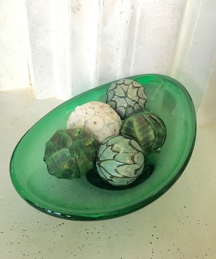 A personal favorite from my Etsy shop https://www.etsy.com/listing/471323615/vintage-green-glass-decorative-bowl