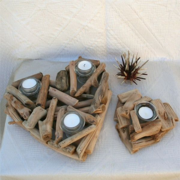 heart-shaped candle holders made of wood sticks