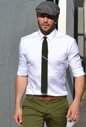 An order of a white oxford shirt, a black skinny tie, a brown leather belt, and olive green slacks please! .