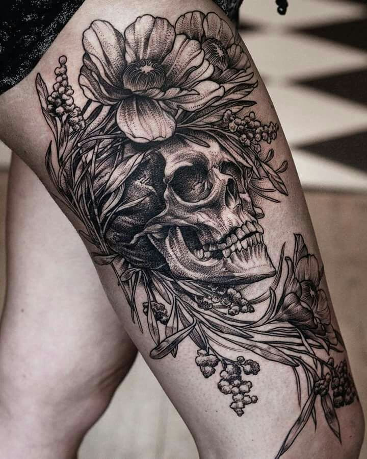How good is this one done by Daniel Baczewski?! Flower and skull Thigh tattoo