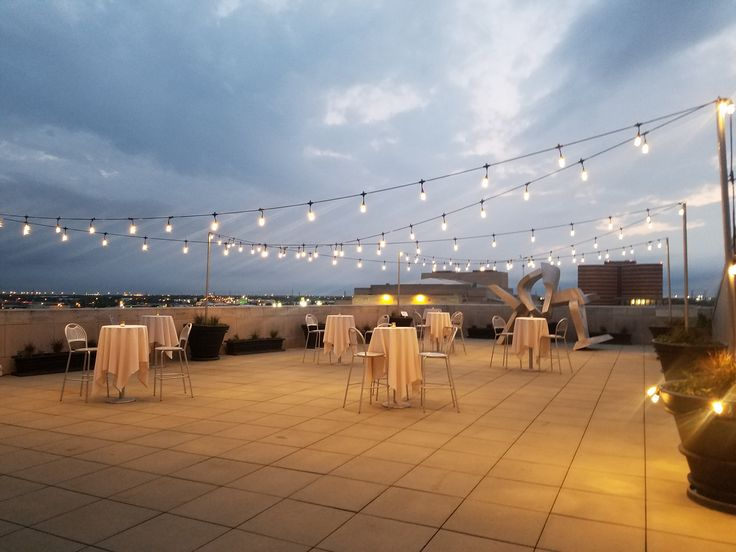 Oklahoma City Rooftop Event | Oklahoma City Museum of Art Roof Terrace | Outdoor Cocktail Hour | Bistro Tables | Votives | String Lights | Outdoor Event Venue | Oklahoma Event Spaces | Downtown OKC