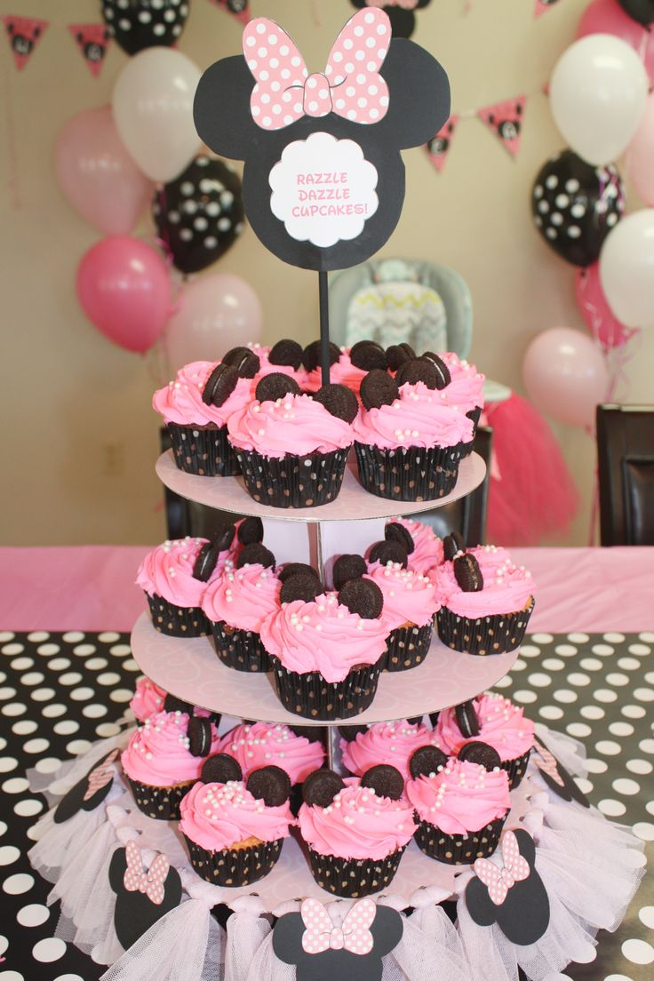 Customized Minnie Mouse cupcake stand with Minnie mouse cupcakes for my grandbaby's 1st birthday party!