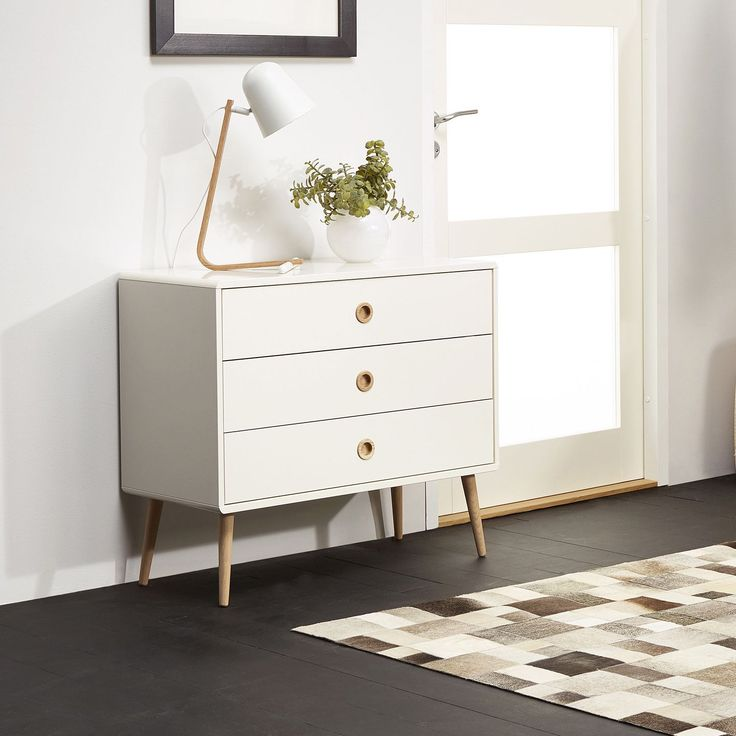 Update your bedroom decor with the Softline Wide 3-drawer Chest. This attractive chest features a mid-century modern design with a brilliant white finish that you will love. It features rounded edges and contrasting oak legs to complete the look.