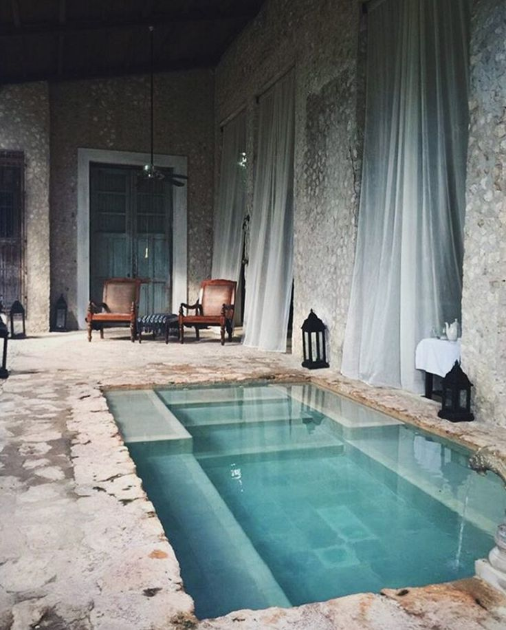 Retreat Yucatan. pool. exposed brick. stone. blue. grey. gray. white. pool…