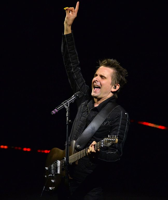 . Matt Bellamy, with the band Muse, sings lead vocals and plays lead guitar during the band�s  �Drones World Tour� concert at Oracle Arena in Oakland, Calif., on Tuesday, Dec. 15, 2015. (Doug Duran/Bay Area News Group):