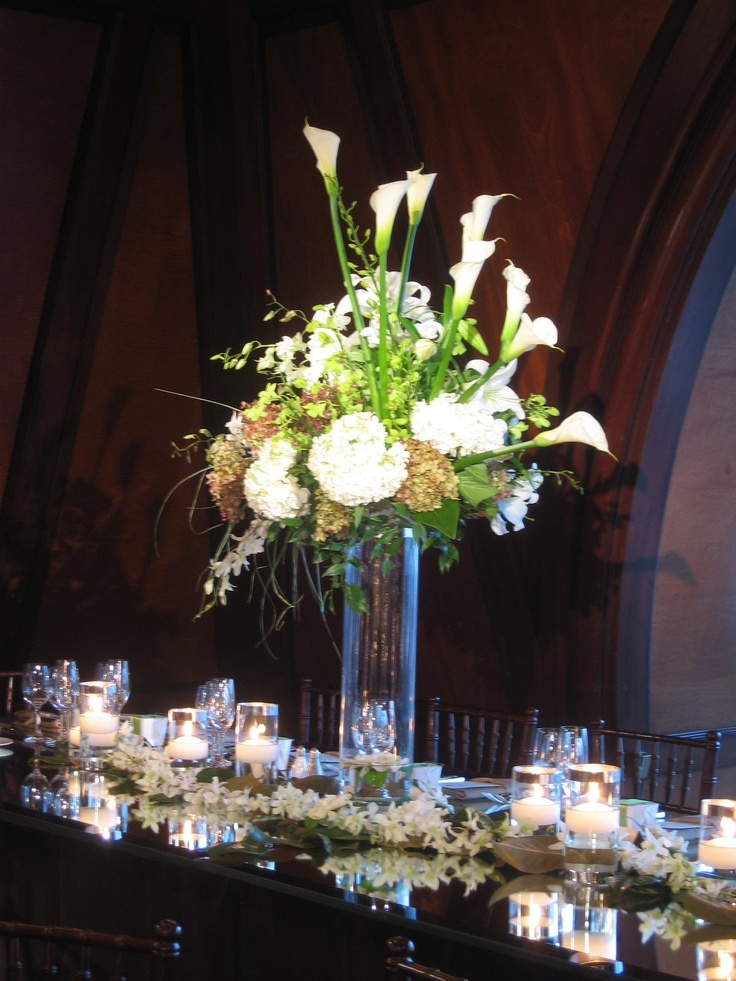 The White Calla Lilies Really Make This Large Fl Centerpiece Stand Out On Head Table