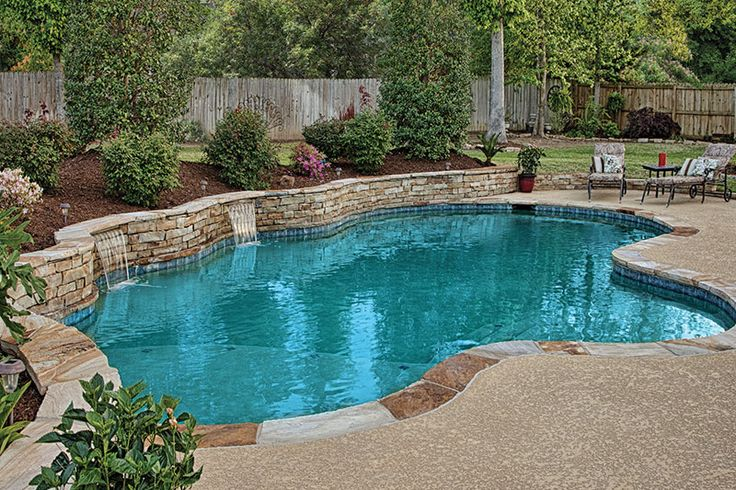 Pools with retaining wall with waterfall 131 photos from for How to design a pool