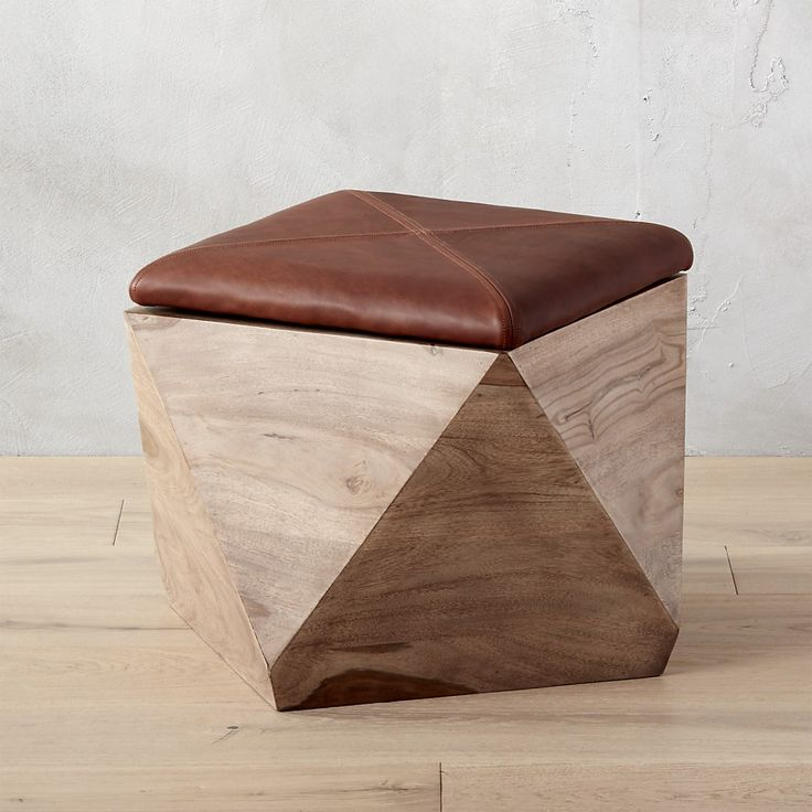 Shop hexagon storage ottoman.   Wooden wonder shapes up as stunning stool, ottoman, and storage for every room.  Shesham wood base stashes everything from books to a blanket; stitched brown leather keeps a lid on things.