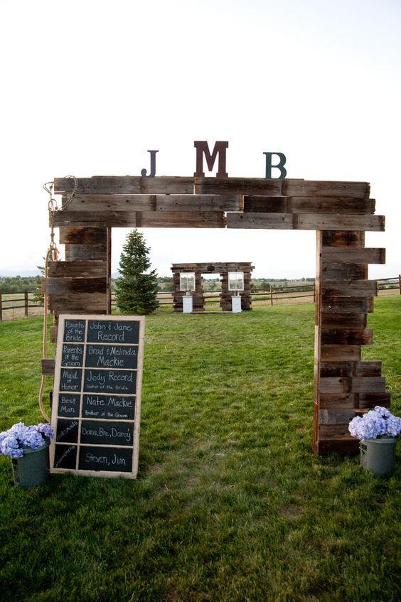 rustic country wooden pallet wedding arch / http://www.himisspuff.com/rustic-wood-pallet-wedding-ideas/6/