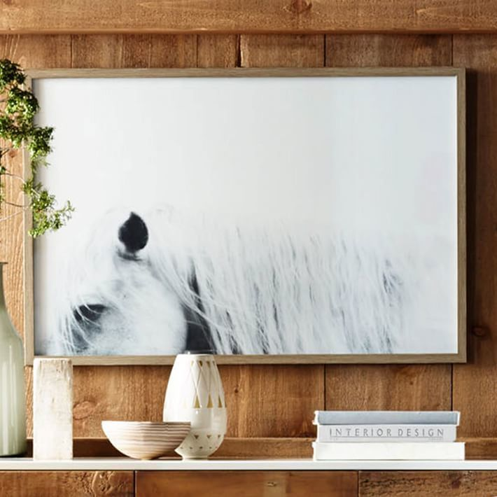 Framed horse print. It looks great on a rustic wood background.