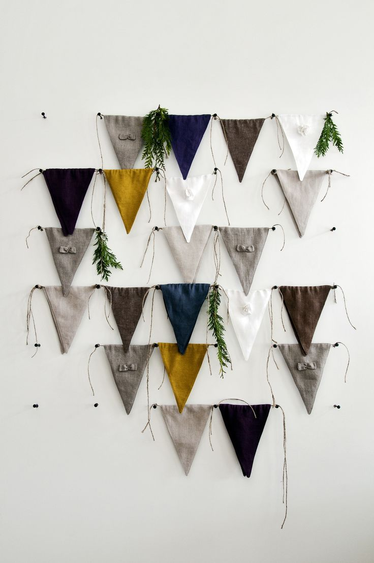 Fresh modern and so natural!  This listing is for ten separate bunting flags that can be tied with each other or can also be tied separately. Hand made of natural linen fabric. We will include a nice mix of natural gray+bow, white+flower, indigo, brown, mustard, violet and oatmeal linen flags.