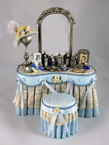 Miniature Ladies Vanity draped in pale blue silk dupioni fabric, with an antique lace overlay and tufted stool