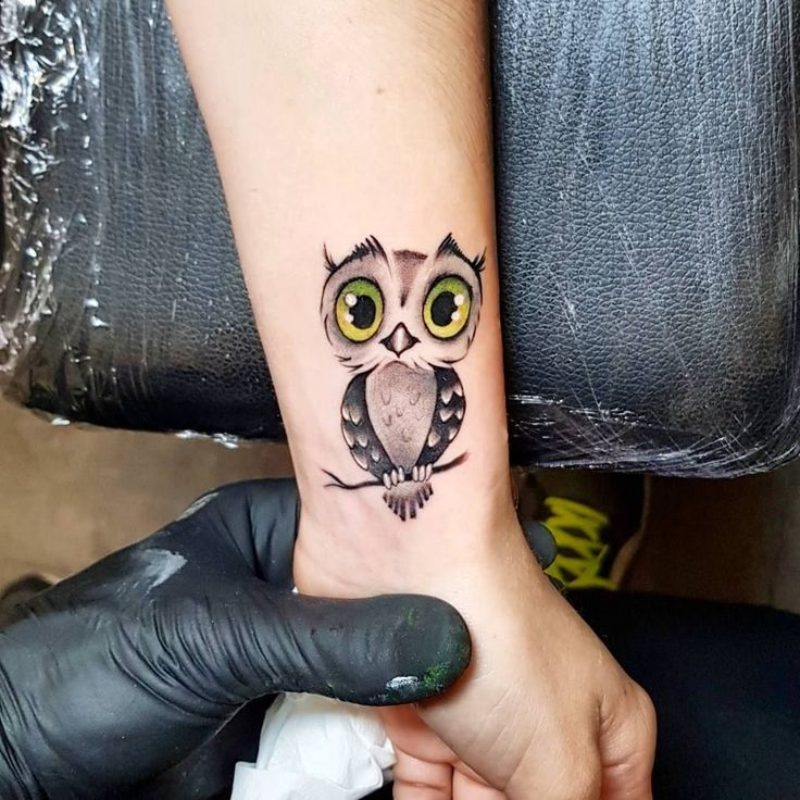 small & cute owl tattoo
