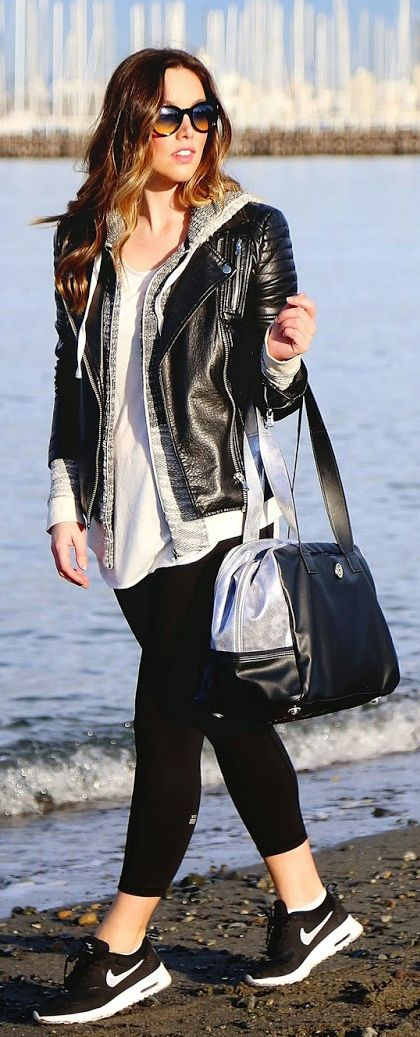 Athleisure Trend: Alexandra Grant is wearing black tights from Victoria's Secret, bag from Lululemon, grey top and hoodie from Gentle Fawn and the leather jacket is from Joe Fresh