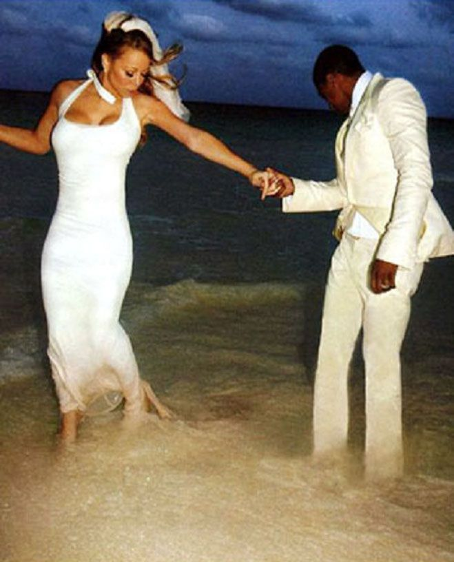 Mariah Carey ~ My favorite picture of her wedding to Nick Cannon ~ when she's comparing the pink at the end of her gown with the Carribean sand :)