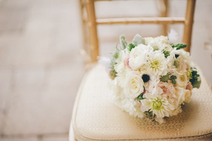 Wedding flowers on a chair at the Stone House in Stirling Ridge. Captured by NJ wedding photographer Ben Lau.