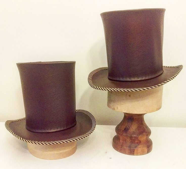 Brown top hats with striped band for Around the World in 80 Days Hat made by Lauren J Ritchie Designed by Lucy Wilkins