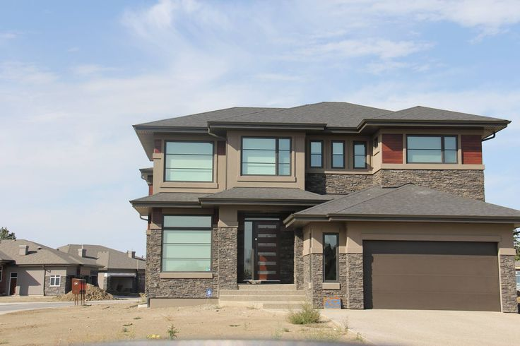 Another stucco & stone project by Ace Lange Homes in Howatt Drive