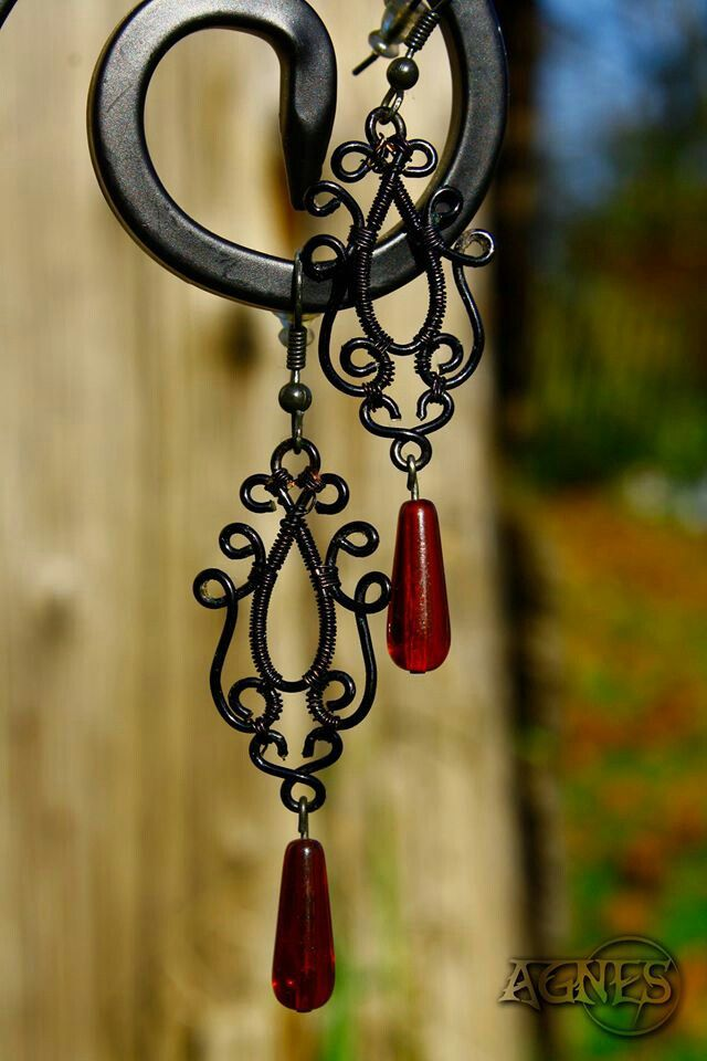 Gothic earrings made from black wire with czech glass bead.