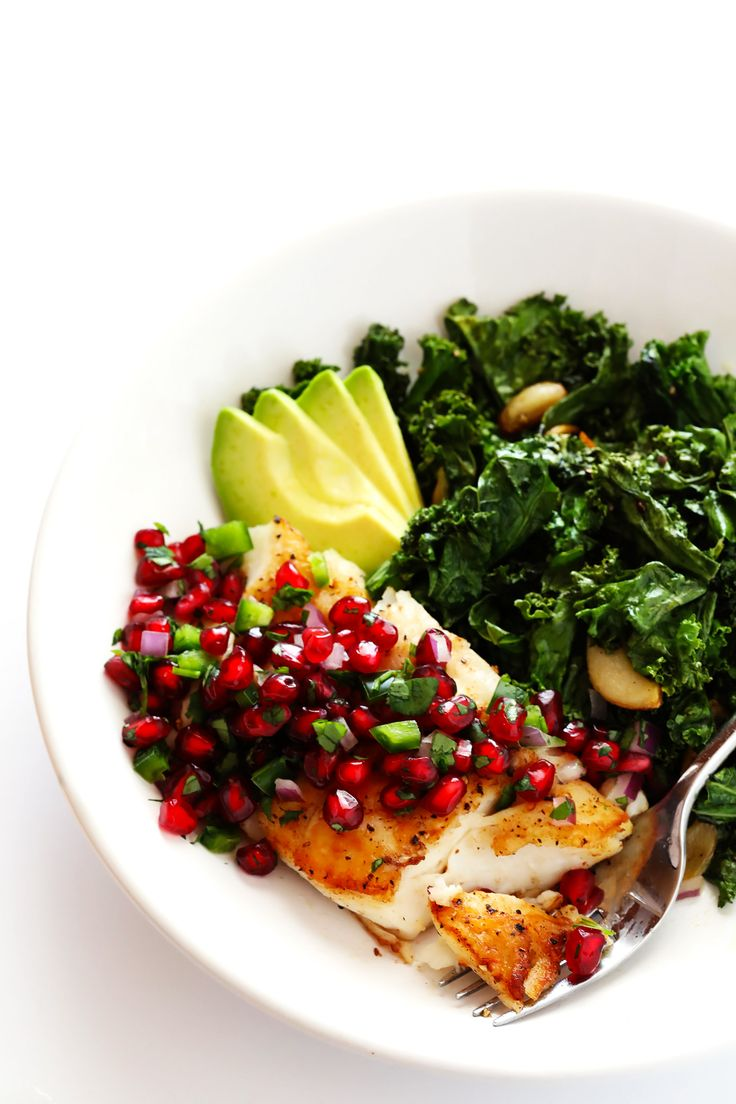 This 20-Minute Pan-Seared Fish is topped with a sweet pomegranate salsa, and serve up with fresh avocado and garlicky kale. It's an quick and easy dinner recipe that you can make with your favorite fish (halibut, cod, salmon, tilapia, etc.) that's also naturally gluten-free, and SO delicious!