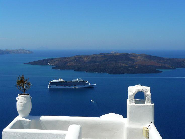 Santorini, Greece - a view from Fira to Caldera and Nea Kameni.  #travel, #destination, #Santorini, #Greece http://travellingwizards.com/destinations/countries/greece/islands/santorini