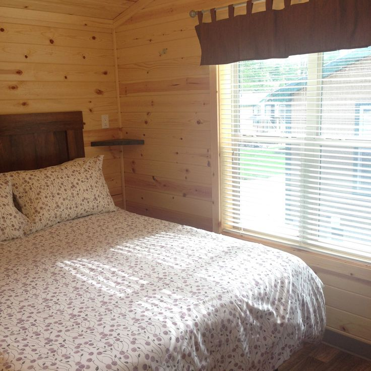 A nice private queen bedroom is the perfect way to end the day of outdoor adventures!  #KOA #Camping #Glamping #Cabin #Summer #Relax #GetOutside