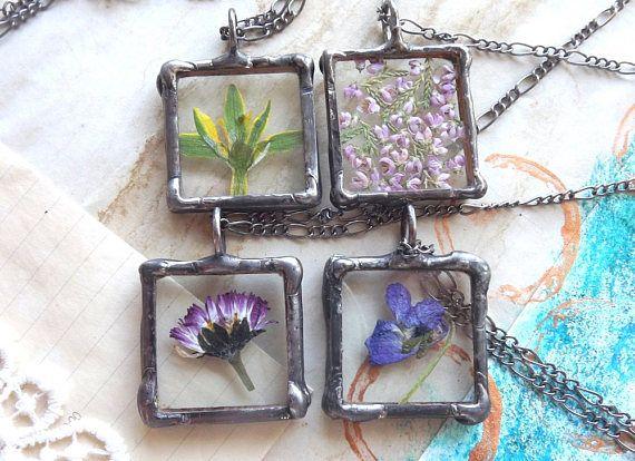 A set of four flower pendantsFlower