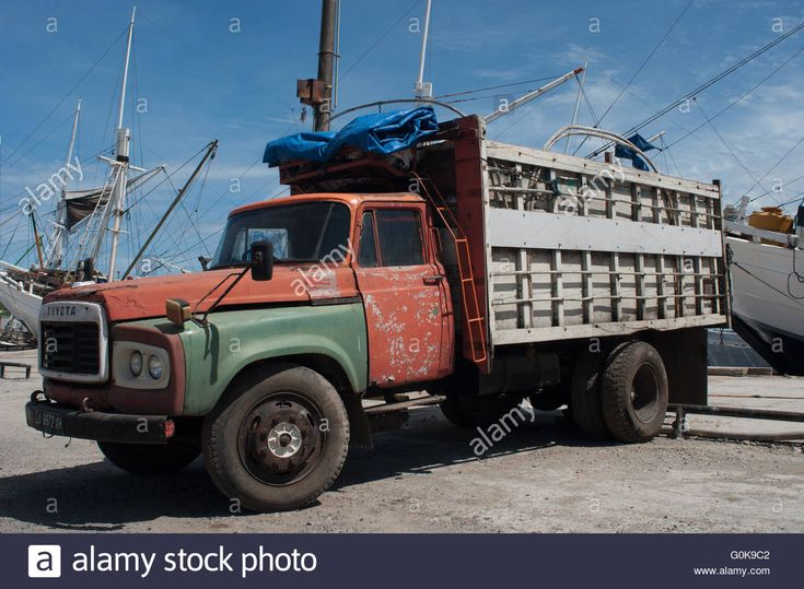 Download this stock image: An old truck parks at Paotere Port in Makassar, Indonesia. - G0K9C2 from Alamy's library of millions of high resolution stock photos, illustrations and vectors.