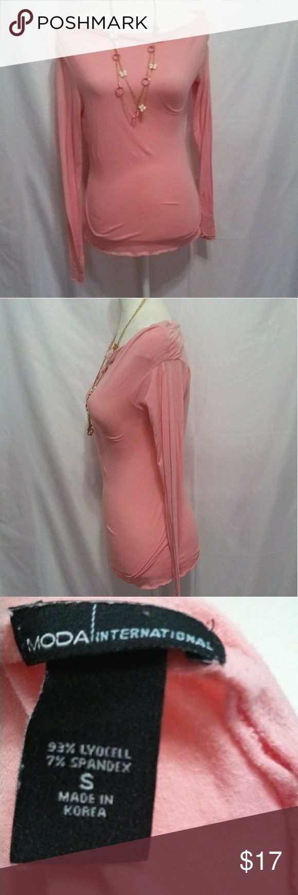 Victoria's Secret Womens long sleeve top.  Size S Victoria's Secret women's Peach long sleeve top. Brand name is m o d a international. This brand was sold out of the Victoria Secret catalog. Moda International Tops Tees - Long Sleeve