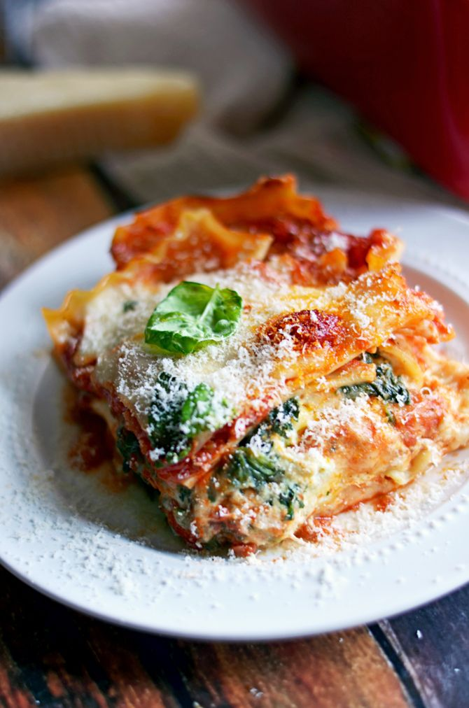 Four Cheese Sausage & Spinach Lasagna.  Everyone says this is the BEST lasagna they've ever eaten! | hostthetoast.com