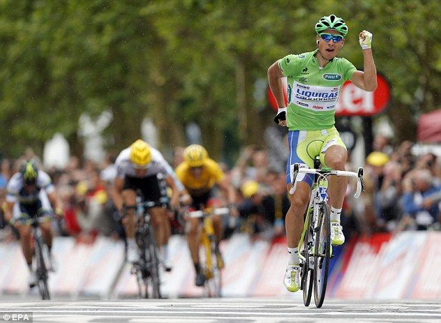 Big winner! In my fantasy team! Sagan of Slovakia celebrates as he crosses the finish line ahead of Fabian Cancellara