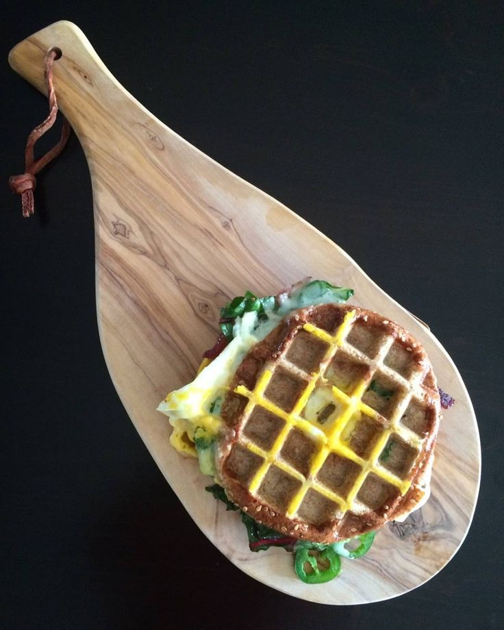 ...and a 'wagel' we go! A quick bite before a power shopping spree to prepare for our 30 person Christmas meal. A sesame bagel with rainbow chard, jalapenos, cheddar, bacon and eggs, pressed in the waffle maker... also known as, a 'Wagel' #sandwich  Have a wonderful day! @zimmysnook