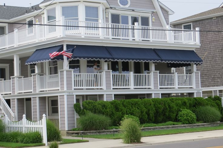 Navy Blue Sunbrella fabric porch awnings fabricated and installed by Kreiders Canvas of Lancaster County PA