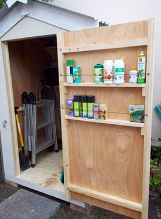 Utilize the inside of your storage shed doors by adding shelving with bungee cord holders for gardening chemicals, spray cans.