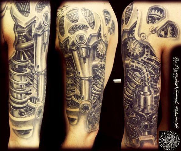 Here is a fantastic Bio-mechanical piece;  Dragons Den Tattoo Shop.