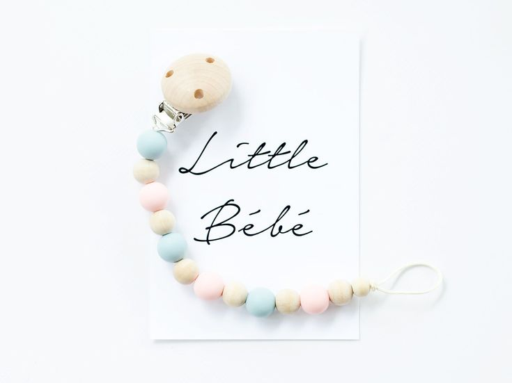 Never drop your little one's dummy again!Our Classic Dummy Chain consists of alternating silicone and wooden beads creating a natural yet high contrast look and finished off with a natural,...