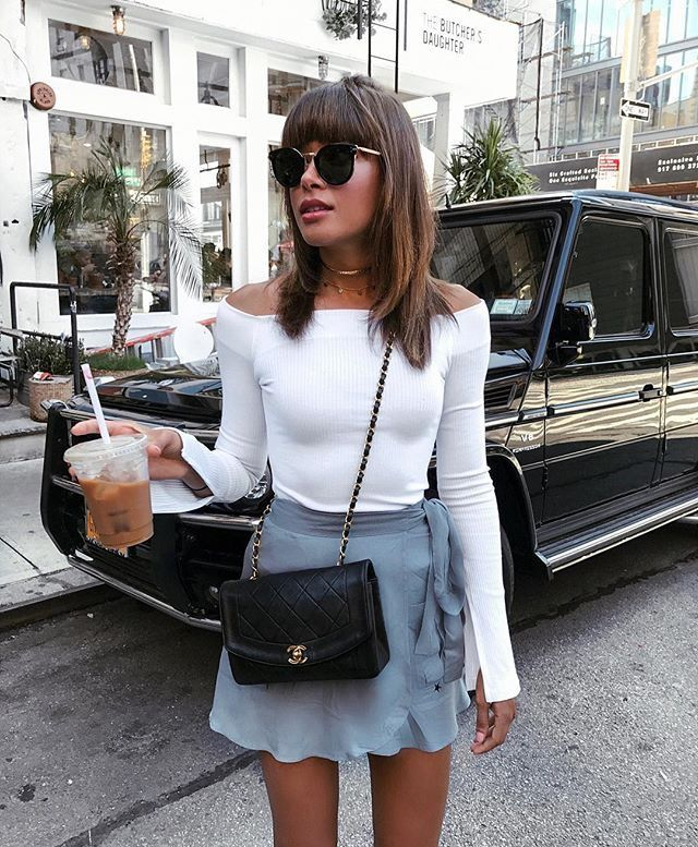 light blue tie waist mini skirt with white fitted blouse | iced coffee city street fashion photo | insta and pinterest @amymckeown5